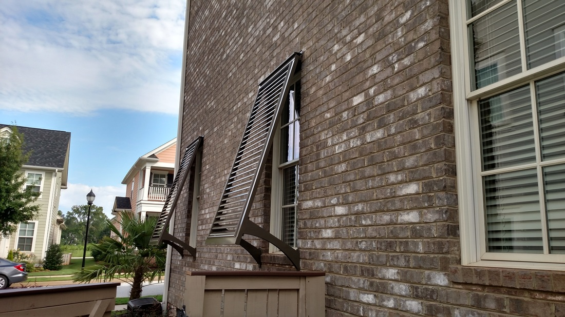 Pair Of Endurance Bahama Shutters With Architectural Stays Powdercoated
